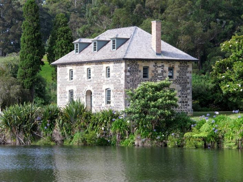 A picture of the historical stone store mission house behind the Kerikeri river.