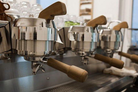 maple wood handles on commercial espresso machine