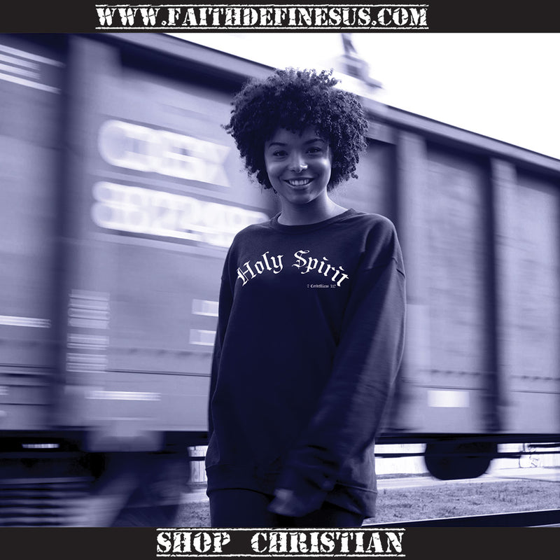 girl wearing black Holy Spirit sweatshirt near a moving train