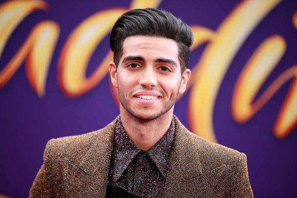 Mena massoud hairstyle windswept quiff straight haircut disconnected undercut Aladdin
