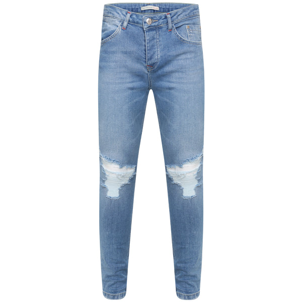 Distressed blue jeans with knee rips