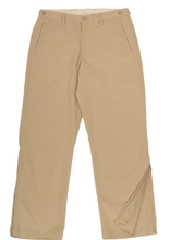 Load image into Gallery viewer, Full-length view of khaki pants demonstrating one leg zipper in unzipped position