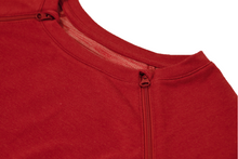 Load image into Gallery viewer, Close-up view of raglan-sleeve dress in tomato color demonstrating detailing of ribbed crew-neck trim, zipper pull covers, and fabric texture