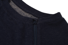 Load image into Gallery viewer, Close-up view of raglan-sleeve top in navy demonstrating detailing of ribbed crew-neck trim, zipper pull covers, and fabric texture