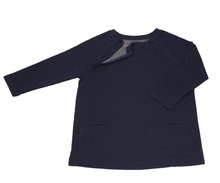 Load image into Gallery viewer, Full view of women's raglan-sleeve top in navy featuring bracelet-length sleeves, two double-welt front pockets, and one upper chest zipper in unzipped position