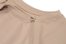 Load image into Gallery viewer, Close-up view of raglan-sleeve top in taupe demonstrating detailing of ribbed crew-neck trim, zipper pull covers, and fabric texture