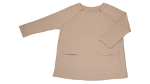 Load image into Gallery viewer, Full view of women's raglan-sleeve top in taupe featuring bracelet-length sleeves, two double-welt front pockets, and both upper chest zippers in zipped position