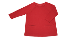 Load image into Gallery viewer, Full view of women's raglan-sleeve top in tomato color featuring bracelet-length sleeves, two double-welt front pockets, and both upper chest zippers in zipped position