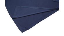 Load image into Gallery viewer, Close-up view of navy polo dress hemline demonstrating side zipper details