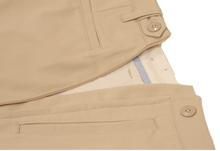 Load image into Gallery viewer, Close-up view of khaki pants to demonstrate detailing of front and rear pocket detailing and expandable side button adjustment