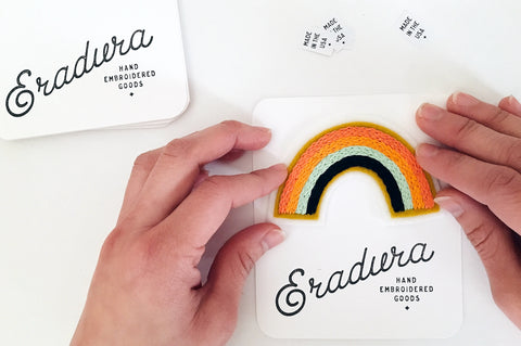 Eradura hand embroidered rainbow patches being packaged for wholesale