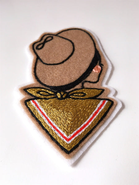 Detail stitching on hand embroidered cowgirl patch