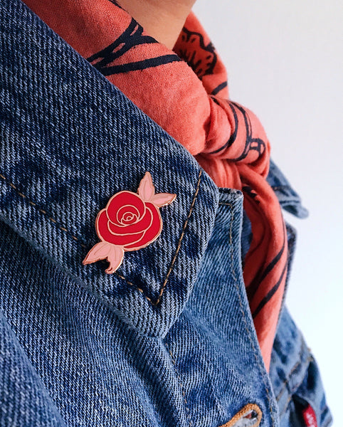 Eradura Desert Rose Enamel Pin in Rose Gold Metallic Finish and Red and Pink Enamel on Denim Jacket