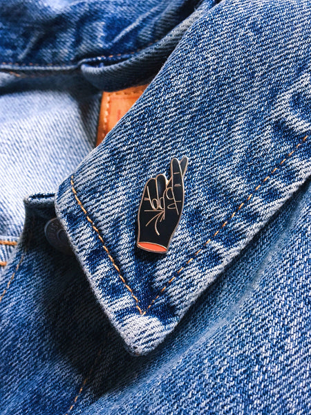 Hard Enamel Fingers Crossed Pin on Denim Jacket Lapel by Eradura Hand Embroidered Goods