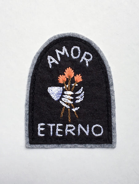 Amor Eterno tombstone patch with skeleton hand and flowers by Eradura Hand Embroidered Goods