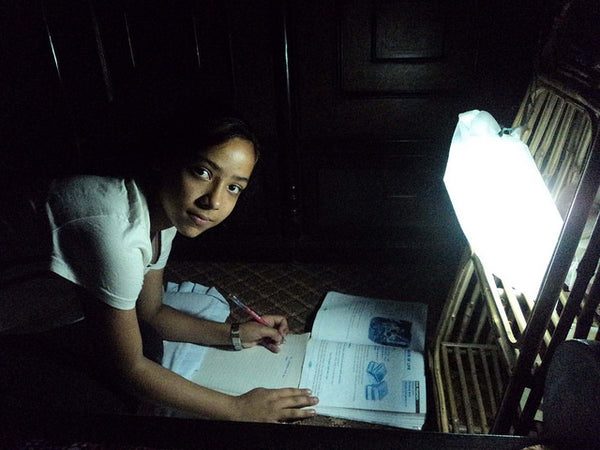 Girl studying in Nepal by LuminAID solar light