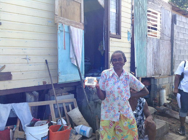 Recipient of LuminAID light in Dominica