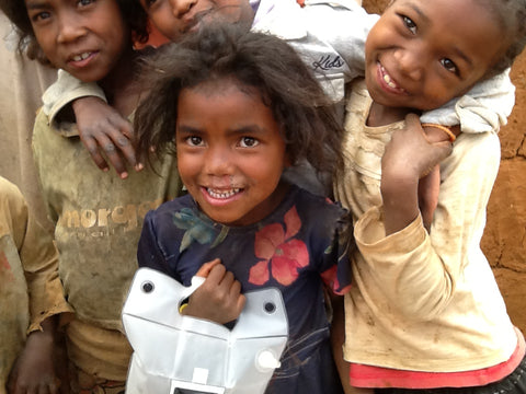 Children holding LuminAID solar lanterns in Madagascar