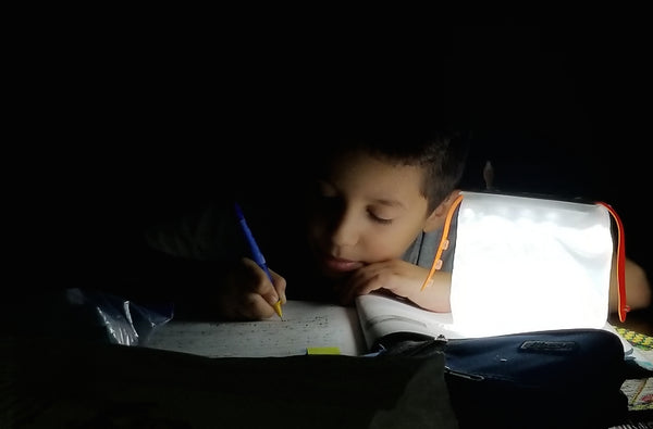 Boy with LuminAID light