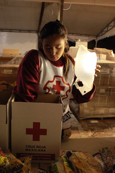 Woman distributing medical aid by LuminAID light in Mexico