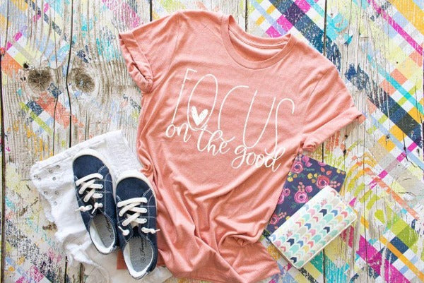 "(1) Short sleeve shirt ""Focus On The Good"" (accessories in the photo are not included)"