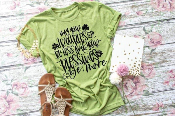 "(1) Short sleeve shirt ""May Your Troubles Be Less And Your Blessings Be More"" (accessories in the photo are not included)."