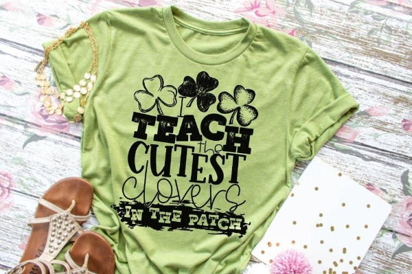 "(1) Short sleeve shirt ""I Teach The Cutest Clovers In The Patch"" (accessories in the photo are not included)."