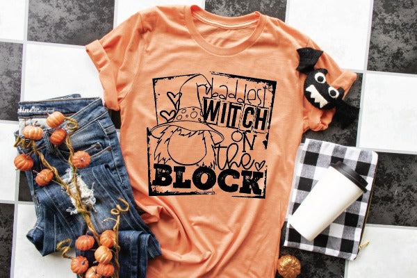"(1) Short sleeve shirt ""Baddest Witch On The Block"" (accessories in the photo are not included)."