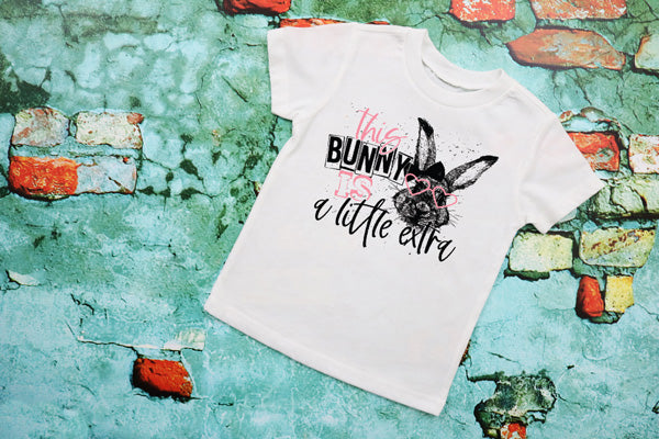 "(1) Short sleeve shirt ""This Bunny Is A Little Extra - Youth Shirt"" (accessories in the photo are not included)."