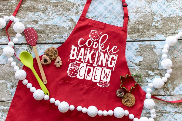 "(1) Red Apron. ""Cookie Baking Crew"" image. (Accessories in the photo are not included)."