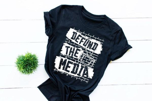 "(1) Short sleeve shirt ""Defund The Media"" (accessories in the photo are not included)."