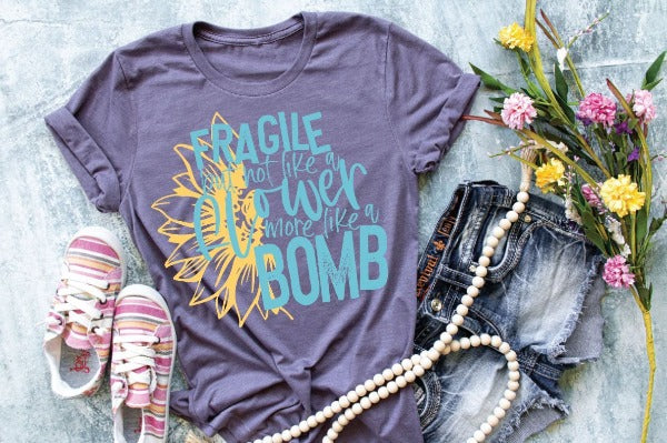 "(1) Short sleeve shirt ""Fragile But Not Like A Flower More Like A Bomb"" (accessories in the photo are not included)"