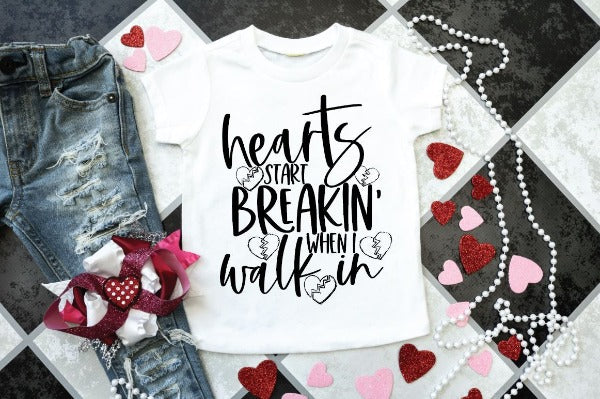 "(1) Short sleeve shirt ""Hearts Start Breakin' When I Walk In - Youth Shirt"" (accessories in the photo are not included)."