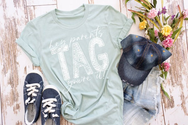 "(1) Short sleeve shirt ""Hey Parents Tag You're It"" (accessories in the photo are not included)."