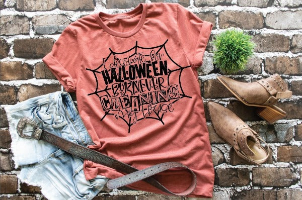 "(1) Short sleeve shirt ""I Decorate For Halloween By Never Cleaning My House"" (accessories in the photo are not included)"