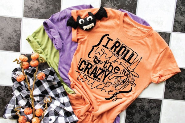 "(1) Short sleeve shirt ""I Roll With The Crazy Witches"" (accessories in the photo are not included)."