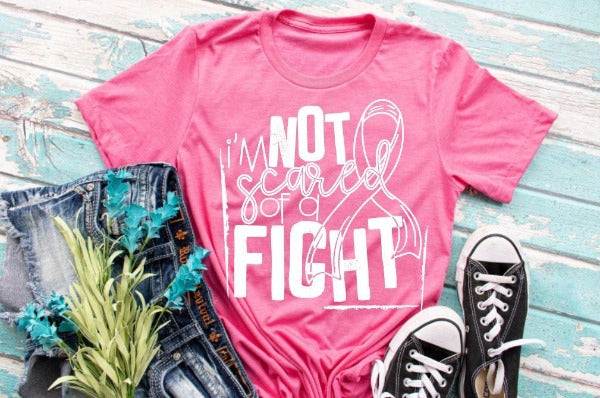 "(1) Short sleeve shirt ""I'm Not Scared Of A Fight"" (accessories in the photo are not included)."