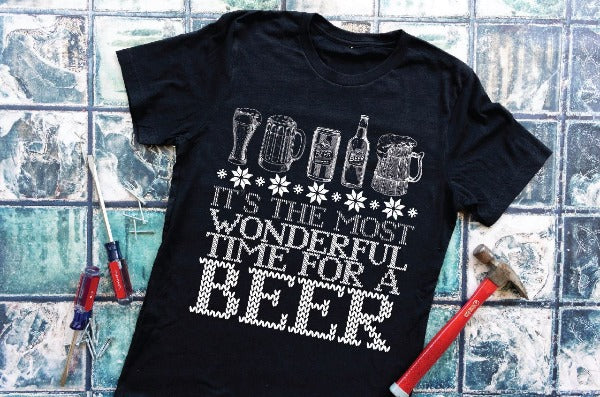 "(1) Short sleeve shirt ""It's The Most Wonderful Time For A Beer"" (accessories in the photo are not included)."