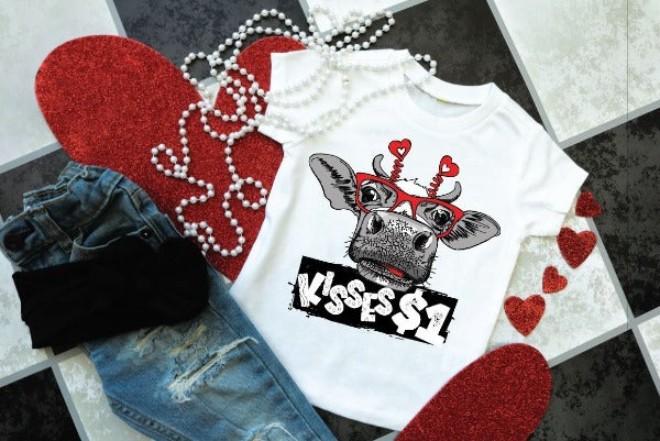 "(1) Short sleeve shirt ""Kisses $1 - Youth Shirt"" (accessories in the photo are not included)."