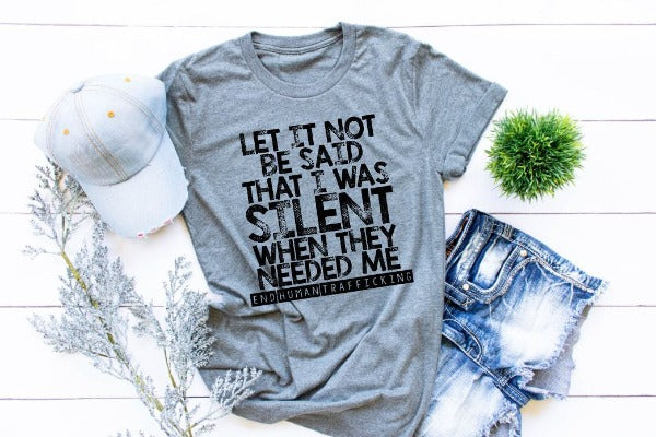 "(1) Short sleeve shirt ""Let It Not Be Said That I Was Silent When They Needed Me (End Human Trafficking)"" (accessories in the photo are not included)."