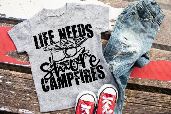 "(1) Short sleeve shirt ""Life Needs S'more Campfires - Youth Shirt"" (accessories in the photo are not included)."