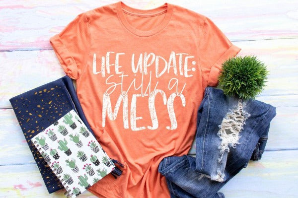 "1) Short sleeve shirt ""Life Update: Still A Mess"" (accessories in the photo are not included)"