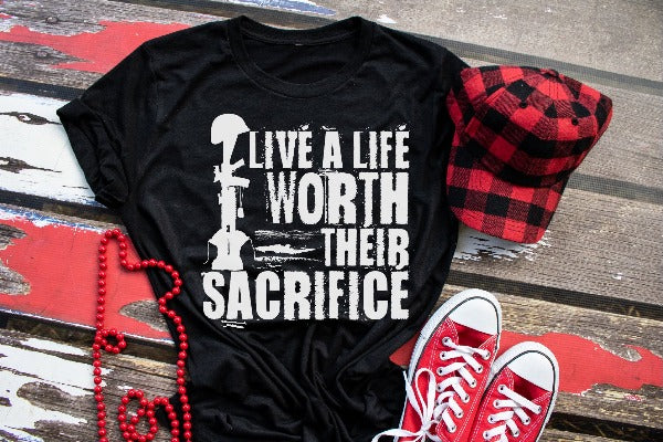 "(1) Short sleeve shirt ""Live A Life Worth Their Sacrifice"" (accessories in the photo are not included)."
