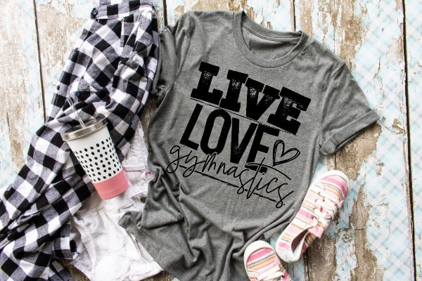 "(1) Short sleeve shirt ""Live Love Gymnastics"" (accessories in the photo are not included)."