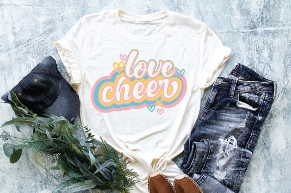 "(1) White short sleeve shirt ""Love Cheer"" (accessories in the photo are not included)"