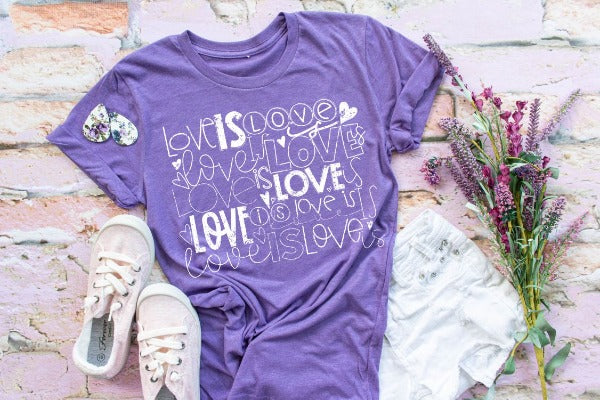 "(1) Short sleeve shirt ""Love Is Love"" (accessories in the photo are not included)"