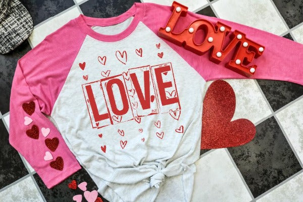 "(1) 3/4 sleeve shirt ""Love Hearts"" (accessories in the photo are not included)."