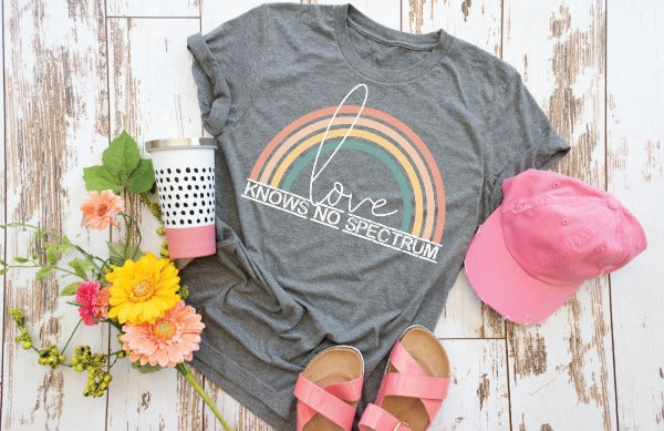 "(1) Short sleeve shirt ""Love Knows No Spectrum"" (accessories in the photo are not included)."