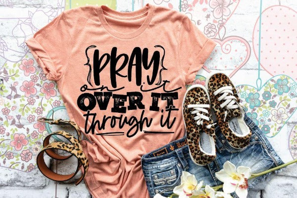 "(1) Short sleeve shirt ""Pray On It Over It Through It"" (accessories in the photo are not included)."