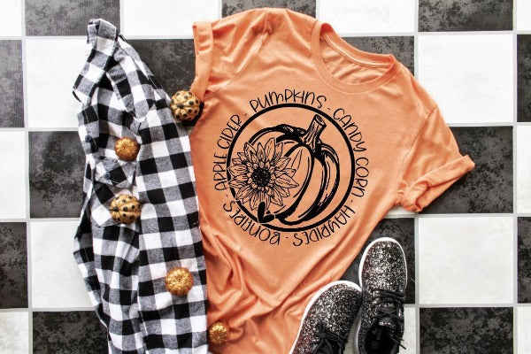 "(1) Short sleeve shirt ""Pumpkins Bonfires"" (accessories in the photo are not included)."